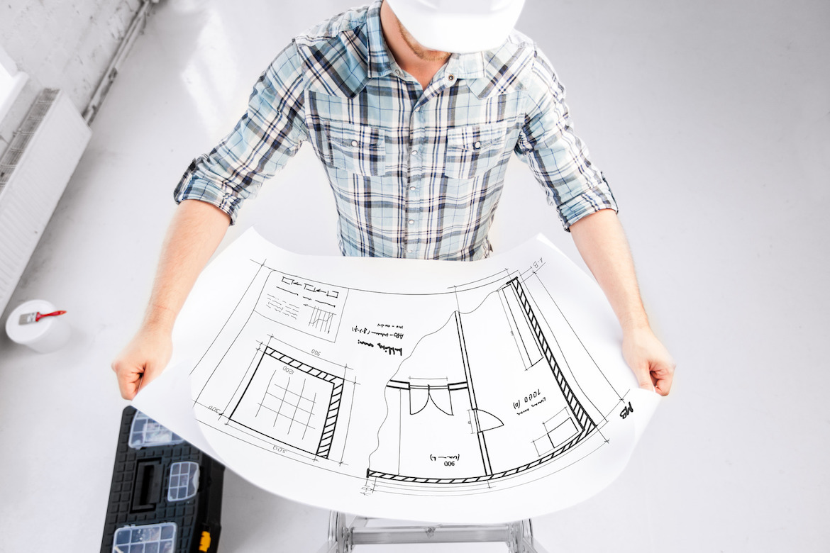 photodune-5506971-male-architect-in-helmet-with-blueprint-m