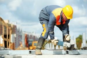 1304526-builder-working-with-cutting-grinder-m