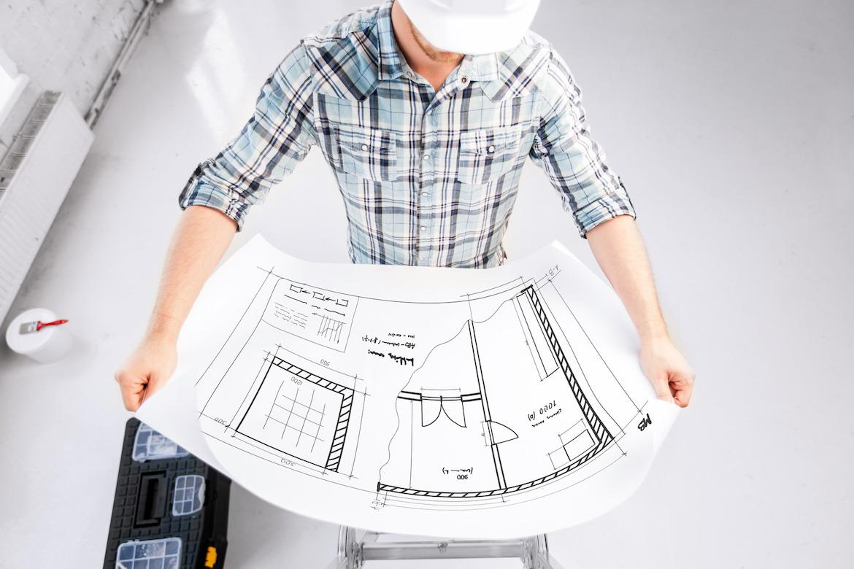 photodune-5506971-male-architect-in-helmet-with-blueprint-m